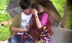 Myanmar girl giving blowjob while dating with her boyfriend in the park