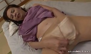Mature woman in pantyhose masturbating fingerin...