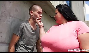 Obese grandma deepthroats young boy outdoors
